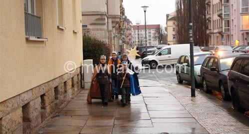 German children going door to door collecting donations