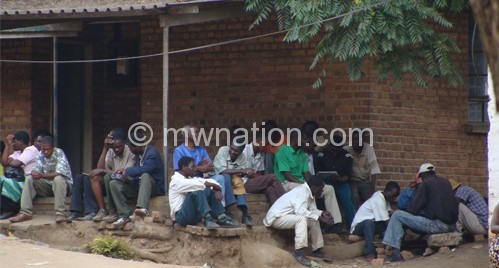 The economy has affected unemployment levels, with many people frequenting labour offices, such as these captured at Blantyre, in search of work