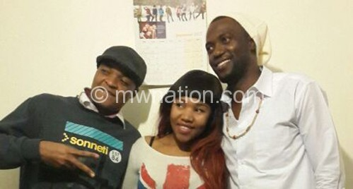 Maskal (R) pictured in Birmingham with a fan and Ireland-based Malawian rapper Pop Dogg (L)