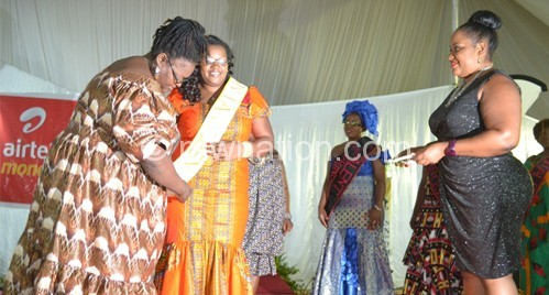 Mbowa (L) crowns Kilembe as the princesses and an official look on