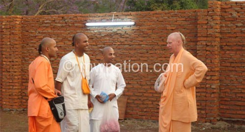 Murari (2nd R) interacts with other members of the church