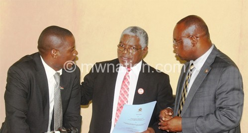 Information PS Luckie Sikwese (L), Mpinganjira (C) and Mkwezalamba confer before the briefing