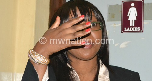 Savala tries to hide her face on arrival at the court