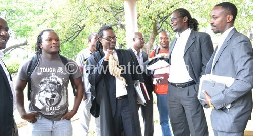 Nkhata (C) with fellow lawyers and activists at the court