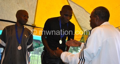 Kalombo (R) congratulates