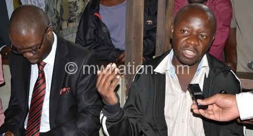 Kasambara (R) and Pika Manondo at the magistrate's court