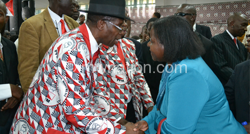 Katsonga Phiri (R) greets a delegate at the convention