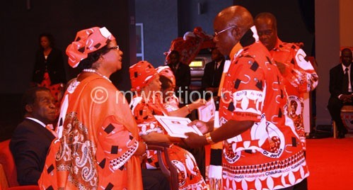 Banda (L) presents a certificate to one of the aspiring MPs