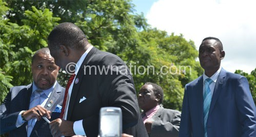 Chilima (L) stressing a point to Mutharika en route to Blantyre CBD yesterday