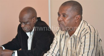 Nyamilandu (R) unveiling Chimodzi (C) and Chamangwana