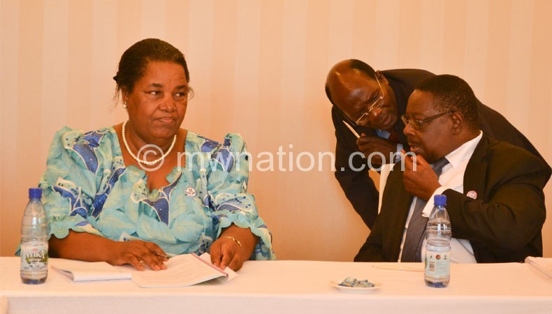 Mutharika conferring with DPP heavyweights Heatherwick Ntaba and Jean Kalilani