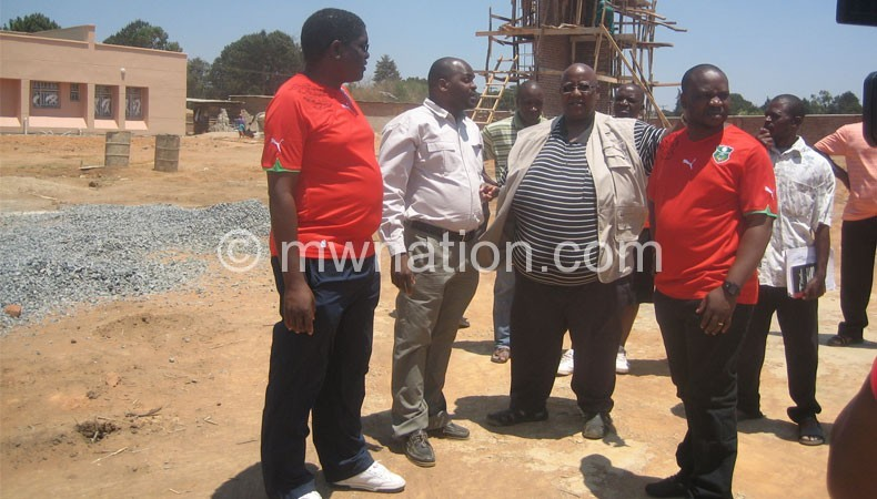 Memelodi (3rdL) with FAM officials inspect the Mzuzu project