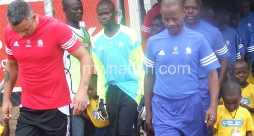 Fish (L) and Mtawali (R) walking into the stadium just before the match