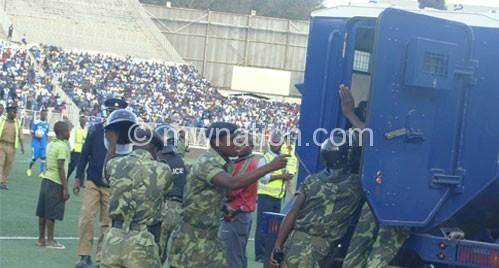 Police containing some ugly scenes at Kamuzu Stadium