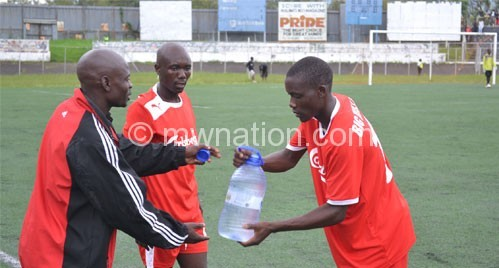 Malunga (L) on duty during Bullets' friendly match against Cobbe