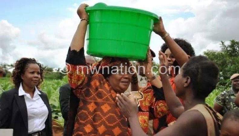 President Banda exemplifying her water-for-all agenda