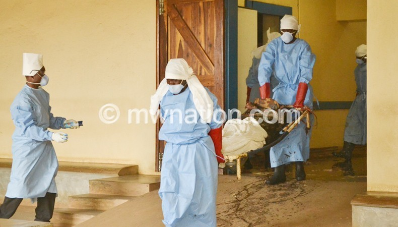 Workers at KCH taking away decomposed bodies from the morgue yesterday