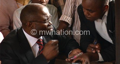 Kasambara speaking to a journalist outside Lilongwe Magistrate's Court on Thursday