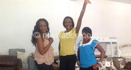 Loga Lemberger (C) posing with Felicia (L) and Mbundundu