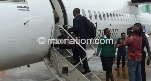 Passengers boarding Malawian Airlines plane at Chileka International Airport yesterday