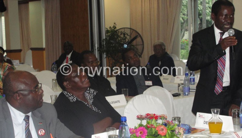 Chiume (standing) emphasising a point during the meeting yesterday