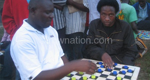 Mkandawire (R) makes a move against his opponent Mhone (L)