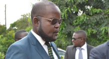 Former budget director Paul Mphwiyo and his bodyguards departing from Lilongwe High Court on Wednesday