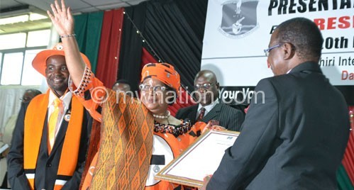 President Banda and Gwengwe (L) present their papers to MEC chairperson Justice Maxon Mbendera