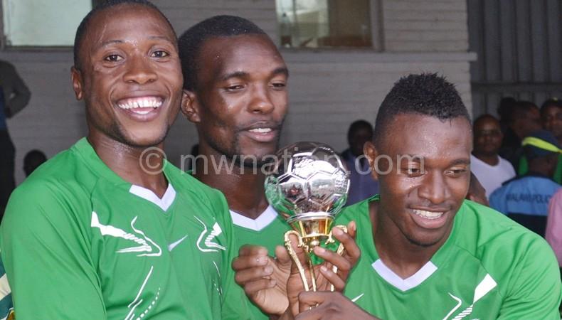 Thindwa (C) and playermates show off the Zambezi Challenge Cup