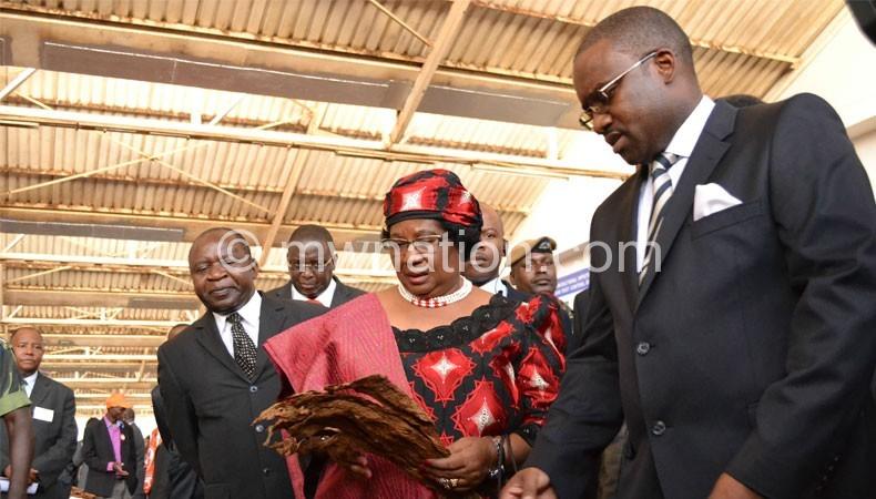 President Joyce Banda admiring  tobacco leaf