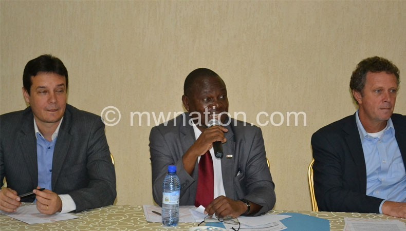 Kanyinji (C) flanked by Rijpma (L) and a UNDP official at the launch