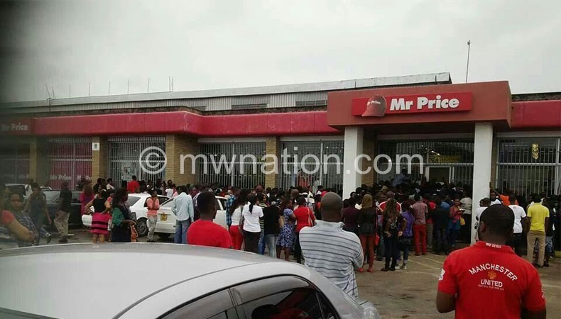 People queue to take advantage of the closing sale at Mr Price shop in Blantyre