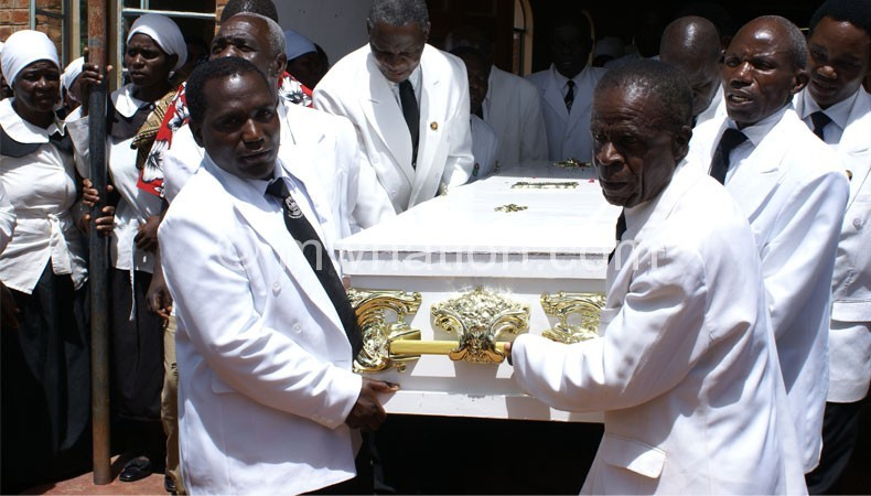 Members of men's guild carry Tito Banda's coffin at Viyele on Thursday