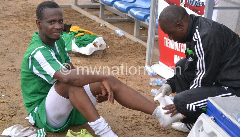 Dalio being treated after being injured during the Zambezi Soccer Challenge