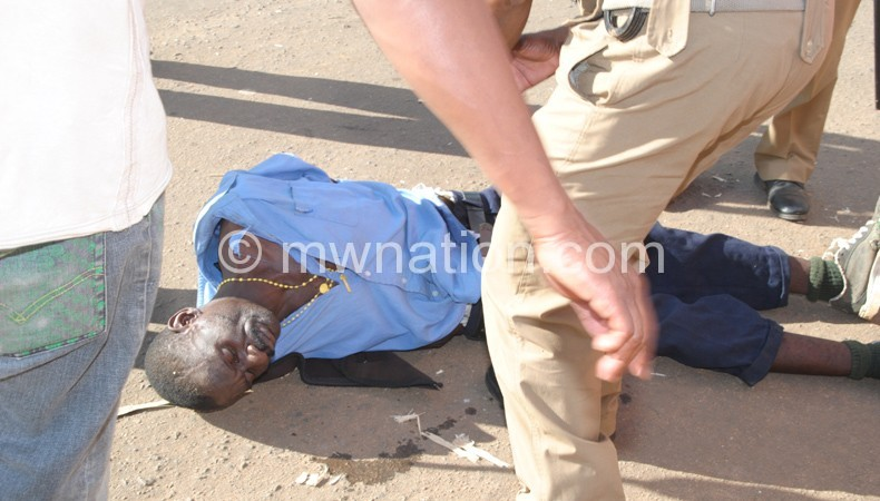 Malawi Police Service officers attending to one of the injured persons at a political event recently.