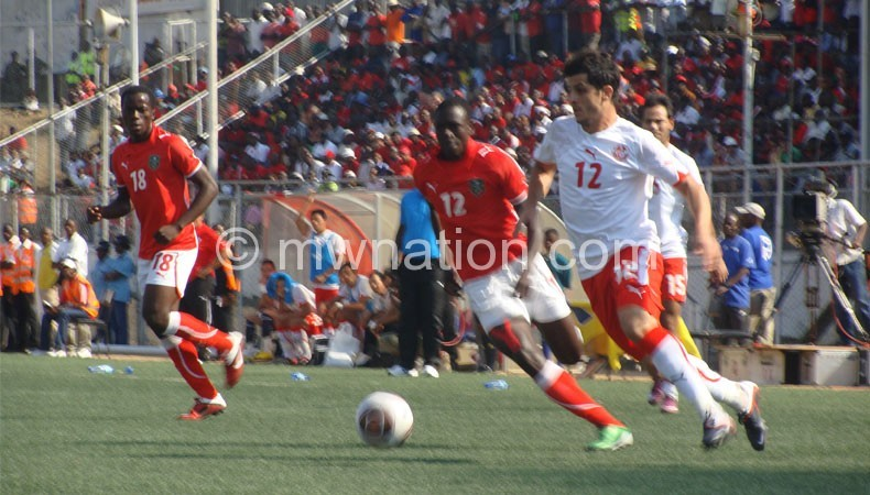 The Flames (in red) in action against Tunisia in 2011 at Kamuzu Stadium