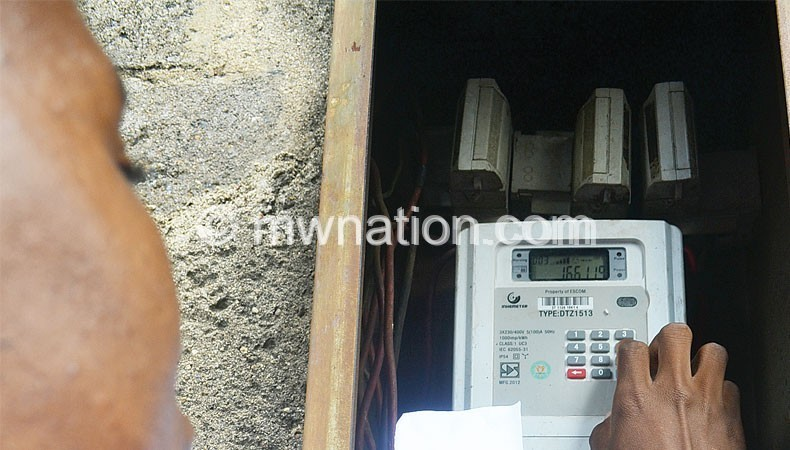 A customer loading electricity units on a pre-paid billing meter