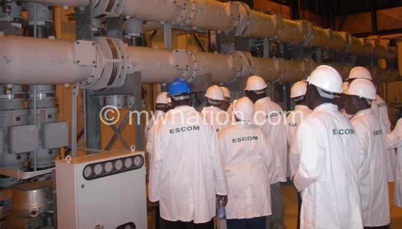 Escom officials inside Kapichila power plant