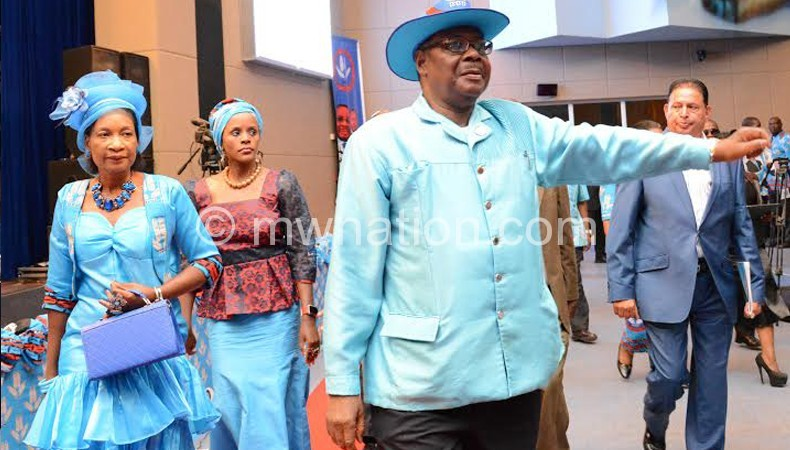 Mutharika gestures on arrival at BICC Sunday for the launch
