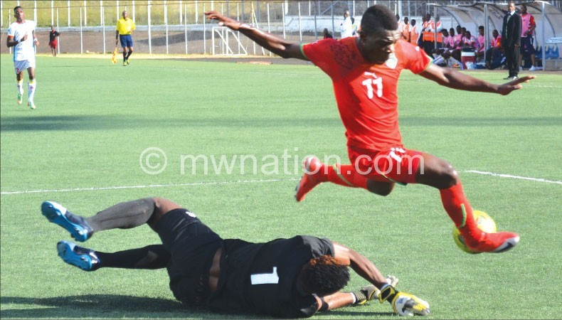 Chawanangwa runs over the DRC goalkeeper with the ball