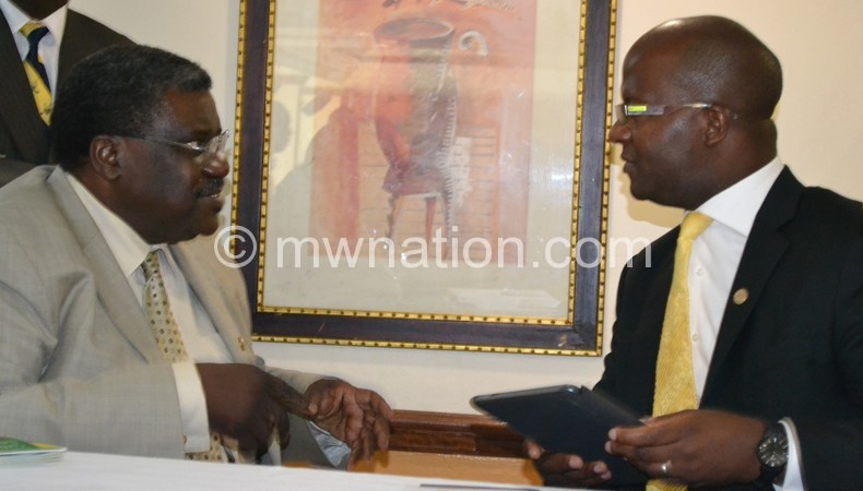 Atupele sharing notes with UDF executive member Victor Mbewe