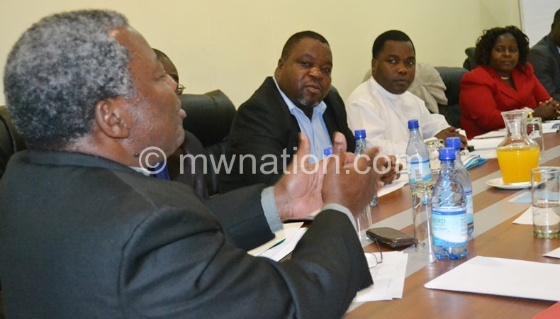 Chingota (L) stressing a point during the meeting with MEC Wednesday
