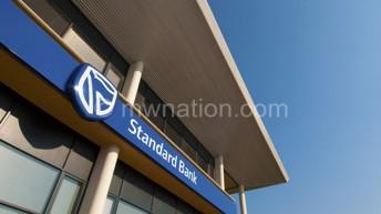 Standard Bank explains 13% profit slump