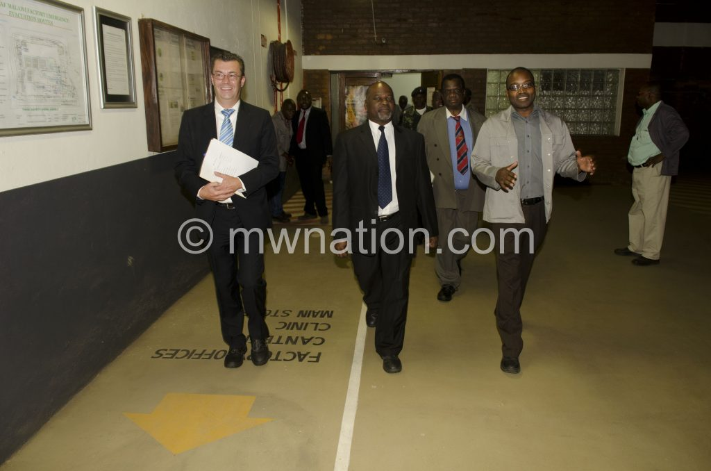 Agriculture Minister Dr Allan Chiyembekeza  flanked by  JTI Managing Director Fries Vanneste and Factory Operations Director Taurai Tongoona during the tour
