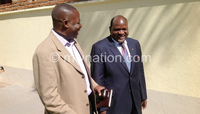 Chimunthu Banda (R) shares lighter moment with Mesn Chairperson Steve Duwa