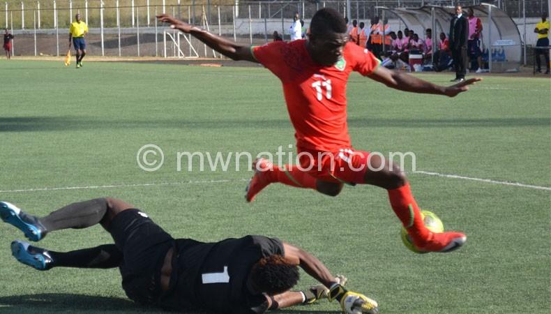 Flashback: Chawanangwa Kawonga (R) beats a Botswana goalkeeper