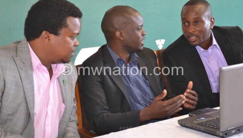 Chirwa (L) during a press conference yesterday