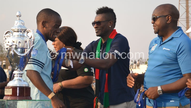 Ghana Captain Asamoah Gyan pledging support to the PTG project in Malawi last year