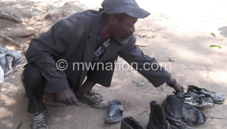 Khanewa with some of the shoe he repair