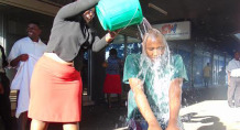 For charity: A woman pours water on Guta